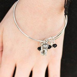 Jewelry - Love Makes The World Go Round Black Bangle